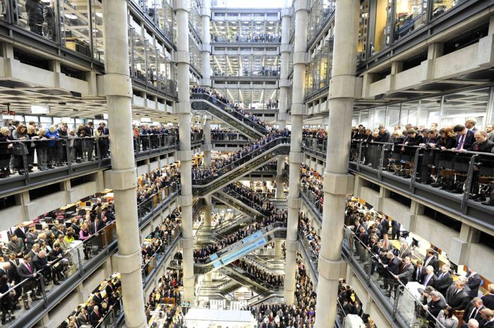 Lloyds of London staff hold their annual Rememberance Day service at the Lloyds Building in the City of London